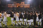 After the game teams give each other high to respect fot the cross town rivalry.