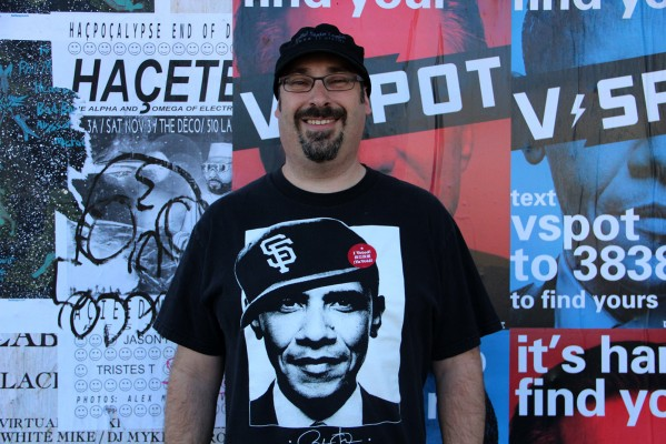 A local voter on Valencia street represents for the Giants and Obama.