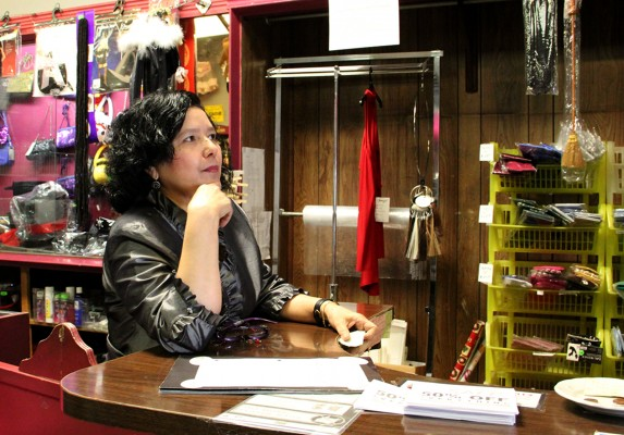 Employee Doris Corrales during the Foxy Lady Boutique's closing sale.