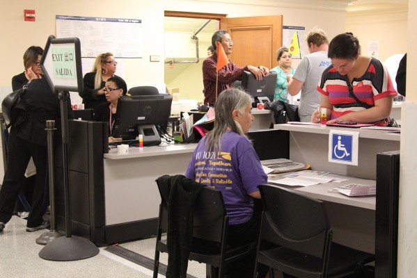 City Hall is bustling with voters Tuesday night as the polls close. Photo by Yousur Alhlou.