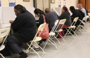 A few of the last voters casting their ballot after 8 p.m. at City Hall Tuesday Night. Photo by Yousur Alhlou.