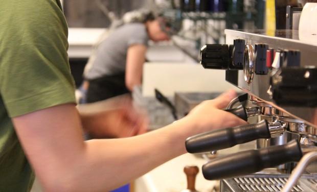 Manager Jude Feldman working in the kitchen at Borderlands Cafe.
