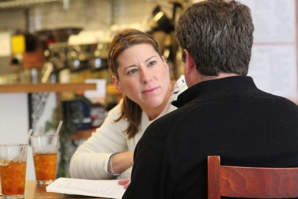 Two customers engaged in deep discussion at Borderlands Cafe.
