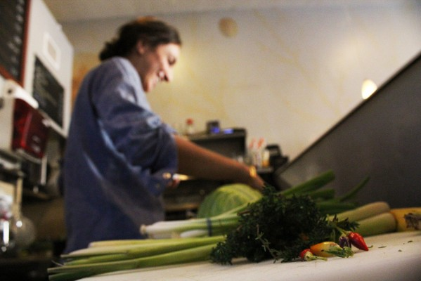 Owner and Chef Shirene Massarweh prepares food.