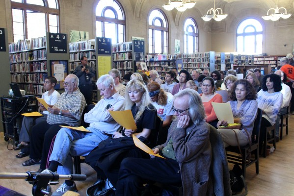 The crowd read along to a recording of Fuentes' work.