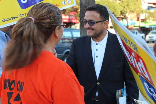 District 9 Supervisor David Campos, who won reelection, campaigning at 24th St. Bart Station Tuesday morning. Photo by Yousur Alhlou.
