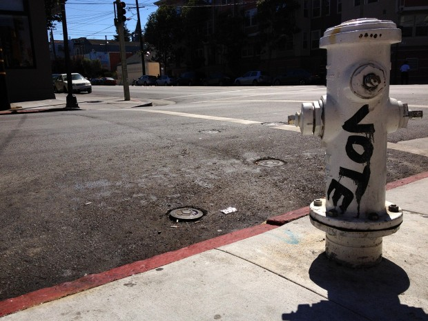 """Image shows a hydrant with the word """"vote"""""""