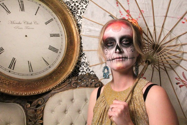 Marina Hudgens of Secret Studios poses with her Day of the Dead makeup.
