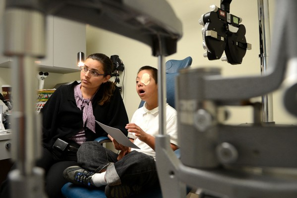 Dr. Alejandra de Alba Campomanes, a Pediatric Ophthalmologist and the director of the new Pediatric Eye Center at SFGH performs an eye exam on 10-year old, Anthony Lopez. Because Anthony has Down Syndrome regular eye exams are critical since he is predisposed for eye ailments, said Campomanes.