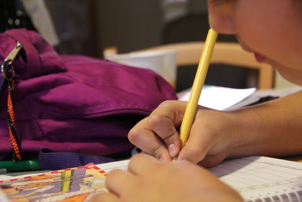 Young girls complete their homework with the help of tutors at Mission Girls, a non-profit that aims to empower women in the Mission District.