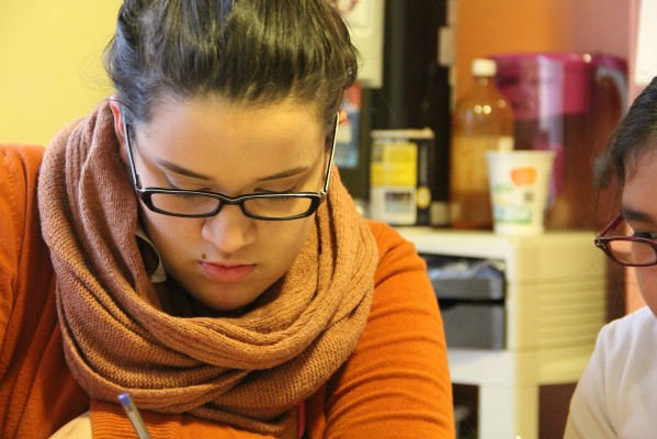 Marisol Perez, 18, tutors girls in the after school study program at Mission Girls Wednesday afternoon. Perez is the youngest paid staffer, and was a participant herself nearly three years ago.