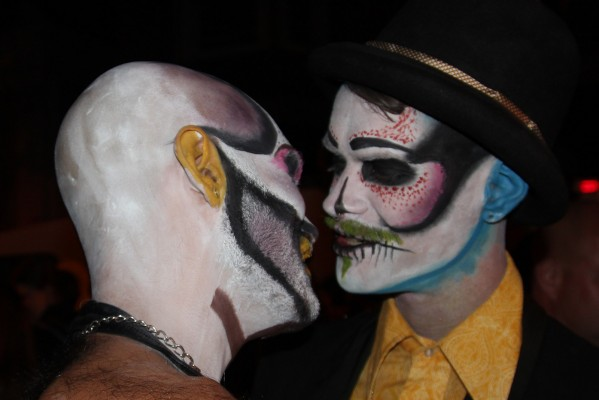 Two skeletons kiss.