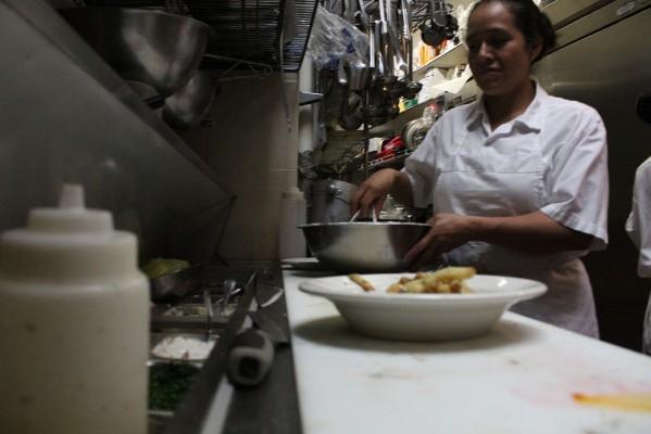 Head Chef Hilda Dias prepares food.