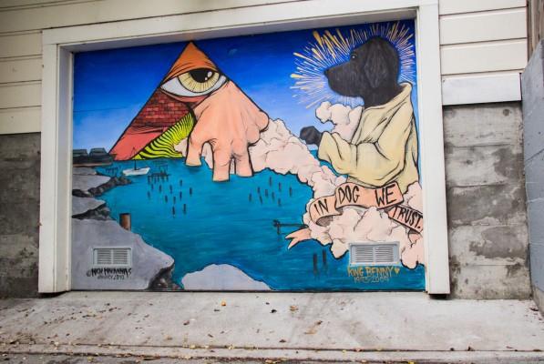 Intricate garage door art in tribute to a former pet.