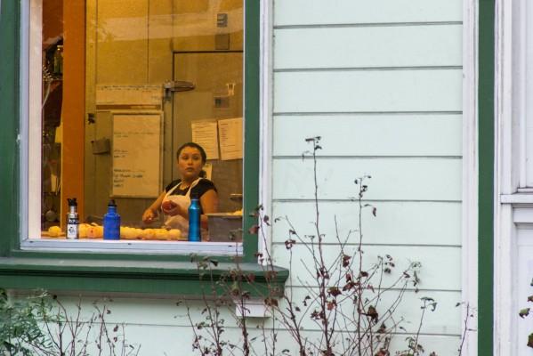 A Mission Pie kitchen worker prepares food.