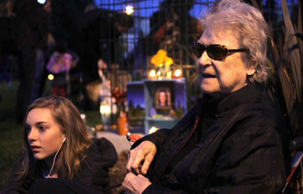 Maggie Lewis (right) mourns the loss of her 37-year-old son, Forest Lewis, who died two months ago from a heart attack stemming from complications of an previous surgery. Earlier on Friday, Lewis, her daughter and granddaughter put together the memorial seen in the background as a way to remember their loved one. Photo by Chelsi...