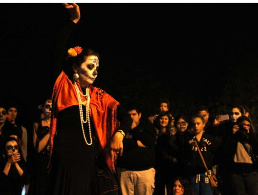 Flamenco dancers entertain the crowds Friday evening in Garfield Square as part of the Day of the Dead festivities. Photo by Chelsi Moy.