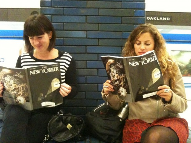 Some engaged train riders enjoy long reads.