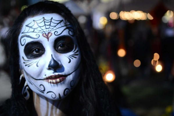 Mission resident, Regina Estioco, was in attendance for the Day of the Dead celebration at Garfield Park on Friday, Nov 2. Photo by Sean Havey