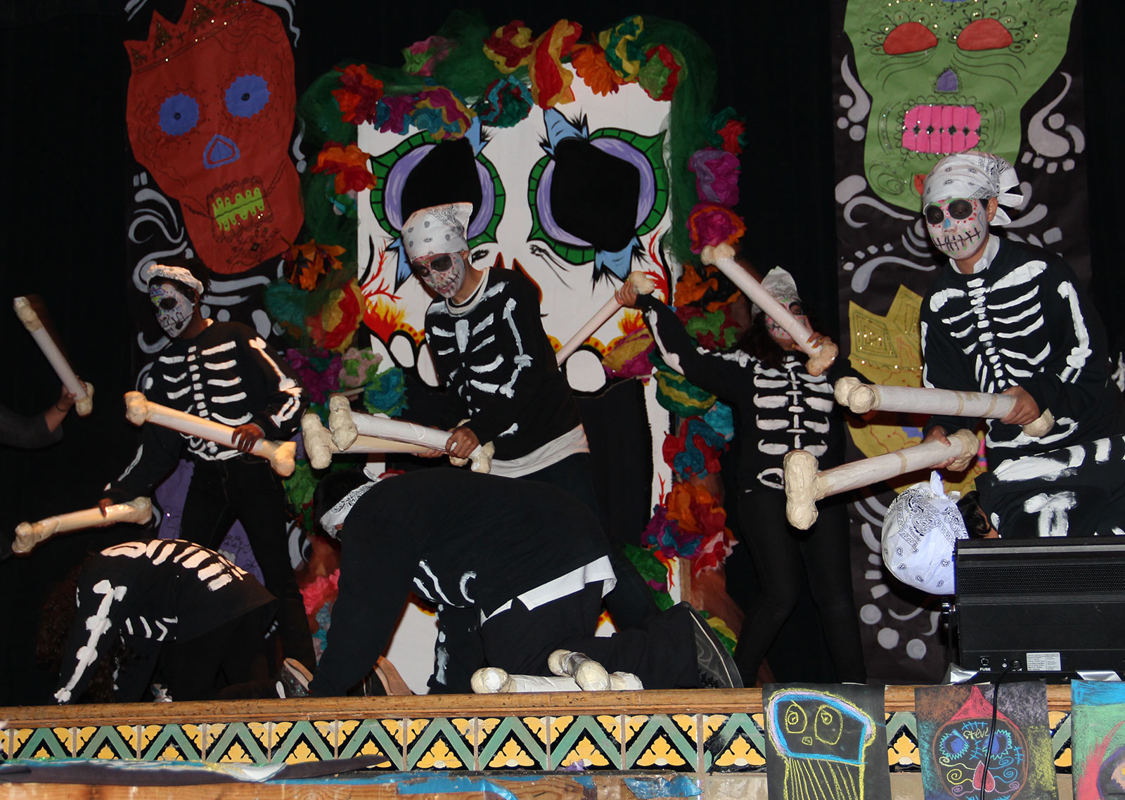 "Skeleton drummers bang to the beat in ""Marcadia."" Music and choreography produced by students. Photo by Erica Hellerstein"