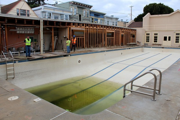 The pool at Mission Playground is mostly empty, save for some greenish water.