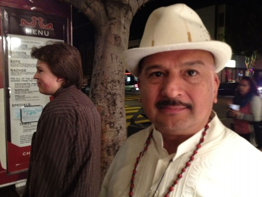 Roberto Hernandez outside of Galeria de la Raza waits in line for traditional Mayan food served by a food truck.