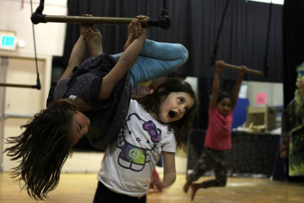 Children learn trapeze during youth theater classes at The Marsh.