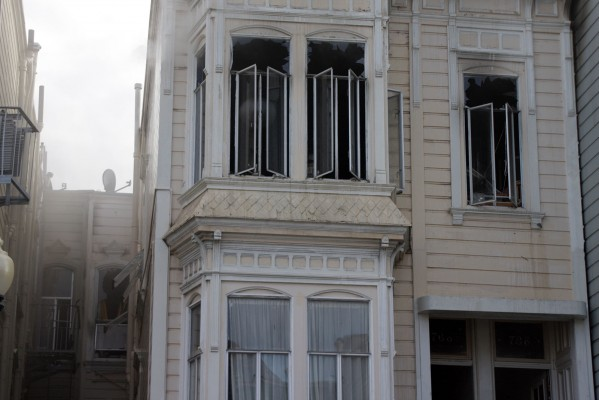 At least three buildings on Capp Street were exposed to the fire, authorities said.