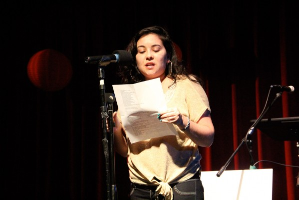 "Dyanna Loeb aka Dyna*Mic reads her piece at the Iluminando El Camino event. ""We really need to know our history as immigrants and stand in solidarity with other immigrants,"" she said."