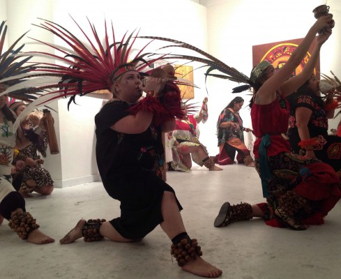 Mayan dancers stop to symbolically worship during their performance.