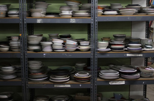 Shelves of plates at the Community Thrift Store.