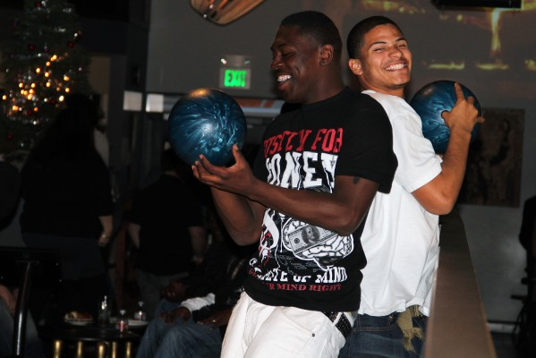 Two teenagers from the youth and family services of Vallejo bowl at Mission Bowling Club.