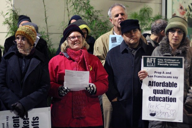 City College faculty and staff sing carols in protest outside the City College Board of Trustee meeting.
