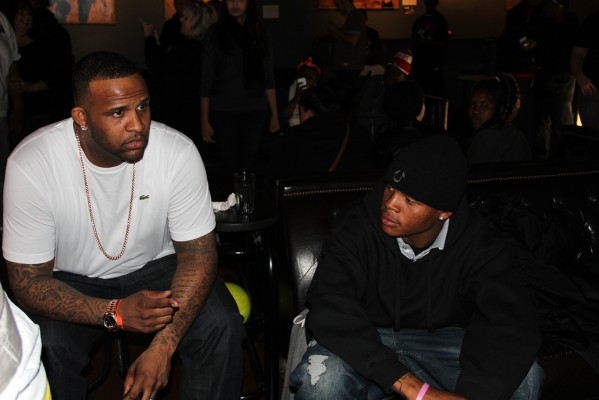 Yankees starting pitcher CC Sabathia talks with youth at an event at Mission Bowling Club.