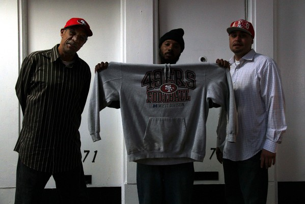 """Vince Alvarado knows the 49ers will win the Super Bowl because they won the other five times they made it. He will watch the game while barbecuing on Lucky Street with friends. """"I'm not hoping, I'm believing,"""" says Alvarado (left) as he stands with Dwayne and Jose (right)."""