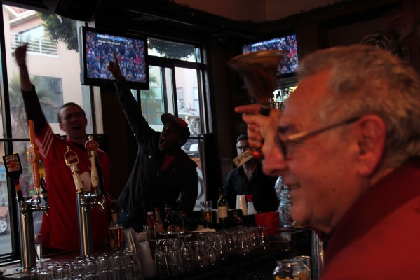 Fans celebrate the 49ers' victory at the Napper Tandy on 24th Street two hours after the final whistle.