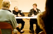 Capt. Robert Moser, left, addresses the crowd gathered Tuesday evening for the monthly community meeting at the San Francisco Police Department's Mission Station. Photo by Chelsi Moy