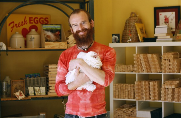 yon Waibel, pictured with the store's chicken, is managing partner of Her Majesty's Secret Beekeeper, a small shop on 3520 20th Street. File photo by Marta Franco.