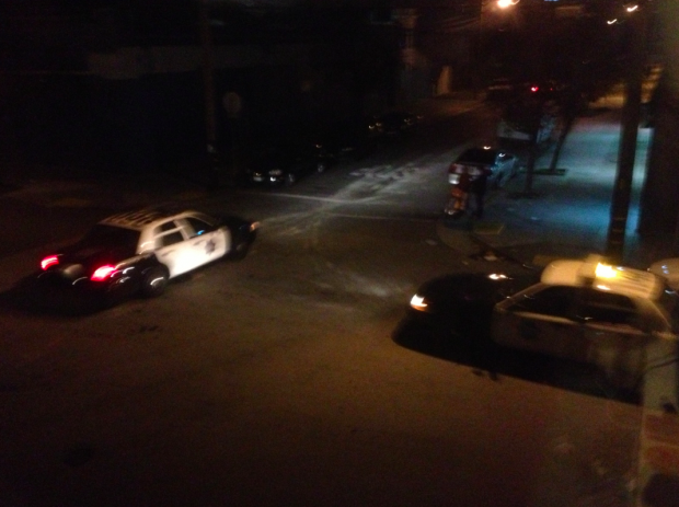 SFPD patrol cars speed off northbound on Shotwell Street as a helicopter hovered above on Tuesday night. The driver never exceeded the speed limits during the chase, according to the Mercury News.