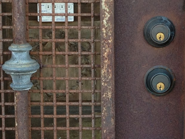A locked door on 17th and Treat streets.