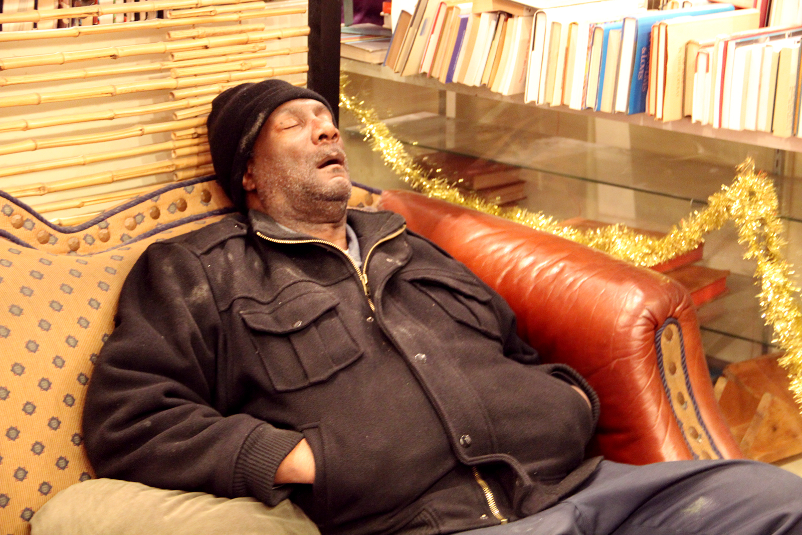 A man takes a nap at Adobe Bookshop. Photo by Molly Oleson