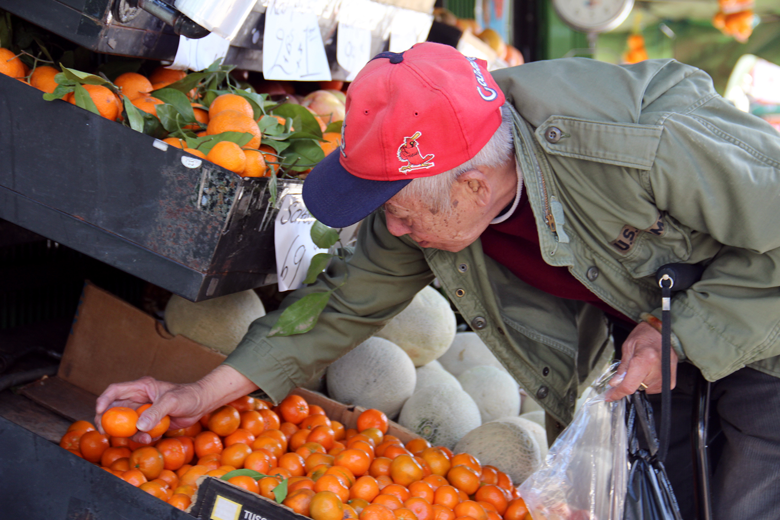 A man looks for fruit on Mission Street.