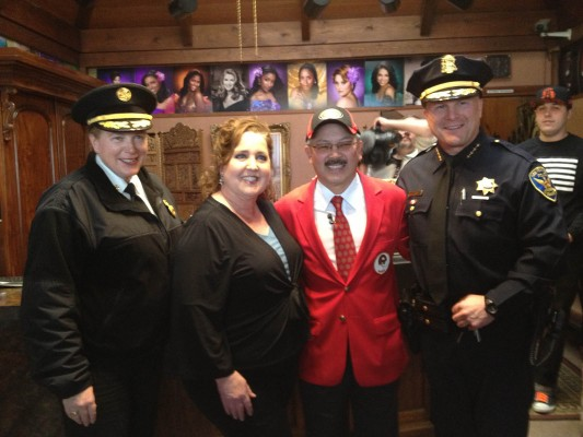 Fire chief Joanne Hayes White, Dore Studio owner Patty Alvarez, Mayor Ed Lee and Police Chief Greg Suhr at Dore Studio.