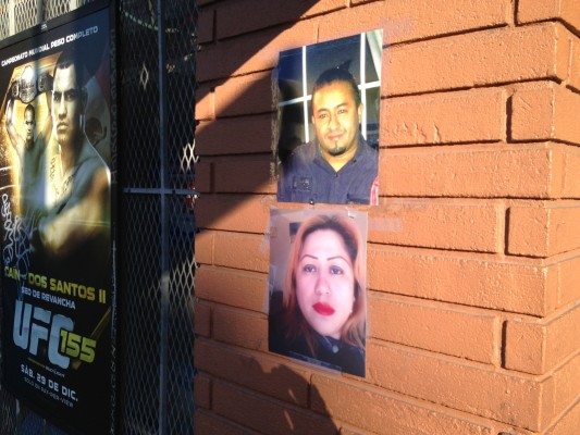The photos of the victims were placed outside Muzio's. Photo by Carly Nairn.