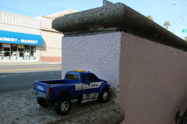 A toy tonka truck left in front of Instituto Familiar de la Raza on Mission St.
