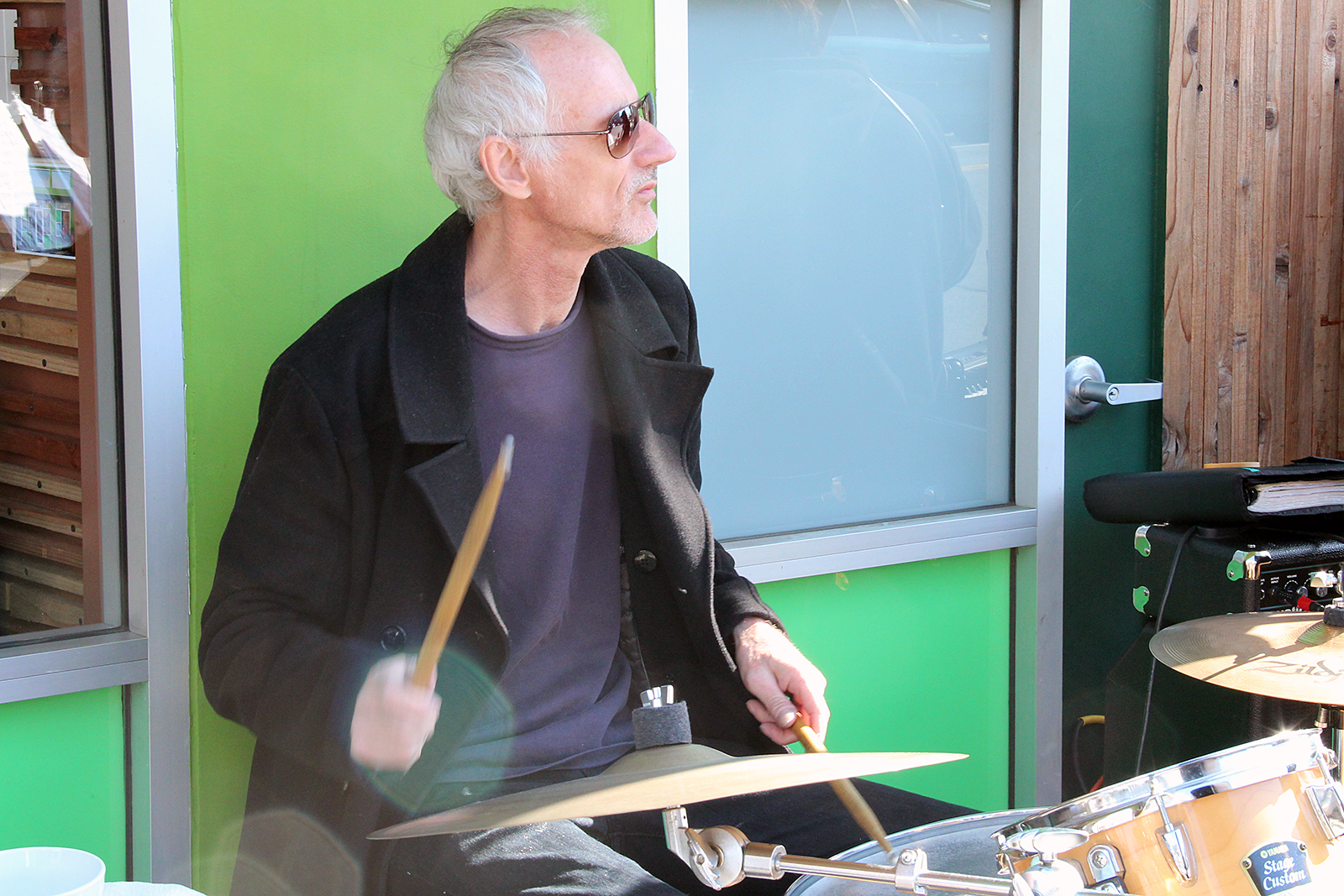 A man drums on Mission Street.