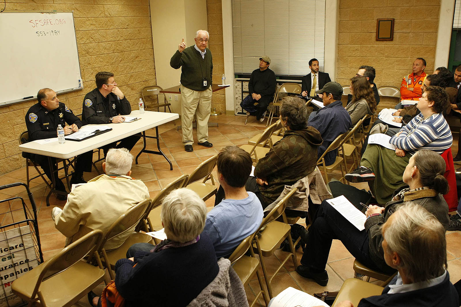 Public Safety Coordinator Jon Shepherd gives the crowd basic safety tips during Tuesday's public police forum.