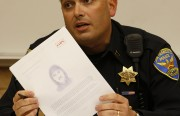 Capt. Robert Moser holds a sketch of a suspect in recent aggravated assault near 23rd Street. The police are asking for the public's help in identifying the man. Photo by Sean Havey