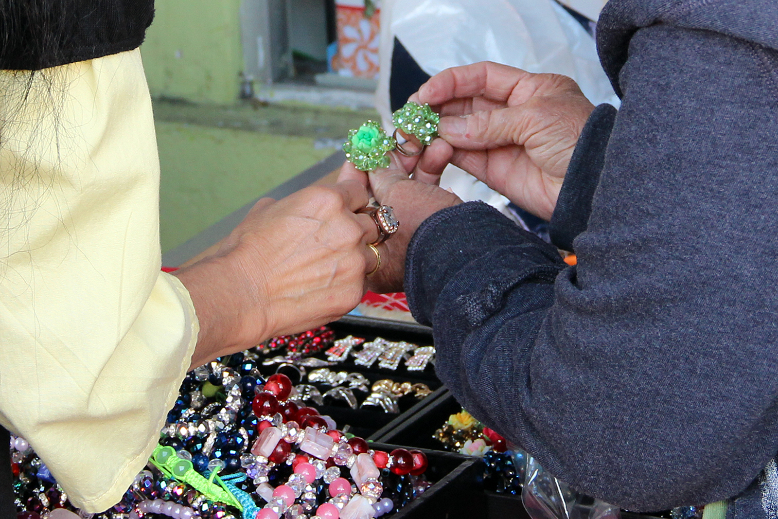 A woman shops for rings on Mission Street.