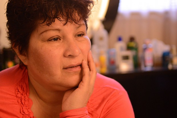Cristina at her home in San Leandro contemplates her return back to Mexico. Photo by Sean Havey.